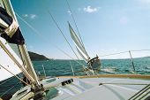 image of sail-boats  - ships sailing and racing with mountains in front - JPG
