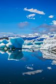 Drift ice Ice Lagoon - Jokulsarlon. Gorgeous morning light in the Ice Lagoon. Icebergs and ice floe poster
