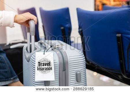 poster of Tourist Traveler With Travel Insurance Tag Suitcase Baggage Put Letter travel Insurance Word For D