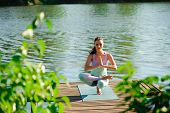 Woman Do Yoga Outdoor. Woman Exercising Vital And Meditation For Fitness Lifestyle Club At The Natur poster