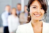 foto of telemarketing  - Female customer support operator with headset and smiling - JPG