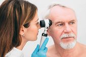 Dermatologist Inspecting Patient Skin Moles At Clinic poster