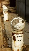Stone Balls On A City Street. Urban Design Fencing Road. Large Outdoor Decorative Large Cracks From poster
