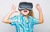 Girl Cute Child With Head Mounted Display On White Background. Virtual Reality Concept. Small Kid Us poster