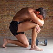 pic of thinkers pose  - muscle shaped man on knee thinking with thinker posture - JPG