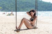 Summer Vacations. Lifestyle Women Swimsuit Bikini Relaxing And Enjoying Swing On The Sand Beach, Fas poster