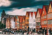 Bergen, Norway. Tourists People Visiting Historical Landmark Houses In Bryggen - Hanseatic Wharf In  poster
