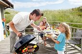picture of chalet  - Family on vacation having barbecue - JPG
