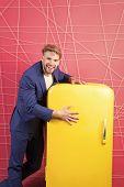 Man Formal Elegant Suit Stand Near Retro Vintage Yellow Refrigerator. Vintage Household Appliances.  poster