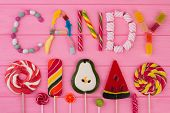 Flat Lay Various Candies And Lollipops. Word Candy Made Of Colorful Candies. Compostion From Differe poster