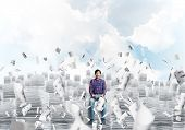 Young Man In Casual Clothing Sitting On Pile Of Documents Among Flying Papers With Cloudly Skyscape  poster