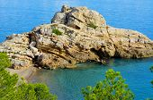 stock photo of nudism  - View of Illot del Torn and the remains of an old watchtower in Torn Beach - JPG