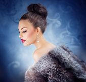 Winter Girl in Luxury Fur Coat. Fashion Fur. Jewelry. Jewellery. Luxury Woman