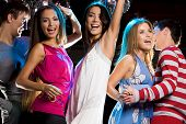 picture of night-club  - Joyful girls dancing in night club with their friends near by - JPG