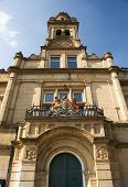 stock photo of magistrate  - skyward view of the victorian gothic magistrates court in halifax with coat of arms above doorway - JPG