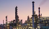 picture of greenpeace  - Oil refinery factory silhouette over sunset with pink sky - JPG