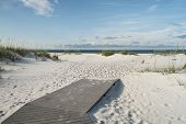 foto of sea oats  - Beach boardwalk footpath meets the sand on beautiful Gulf Coast beach in the early morning - JPG