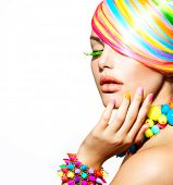 Beauty Girl Portrait with Colorful Makeup, Hair, Nail polish and Accessories. Colourful Studio Shot