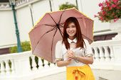 Thai Girl Dressing And Umbrella With Traditional Style (palace Background)