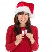 Santa hat Christmas woman holding Christmas gift smiling happy and excited. Cute beautiful Asian san