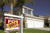 stock photo of real-estate agent  - Red Sold For Sale Real Estate Sign in Front of House. ** Note: Shallow depth of field - JPG