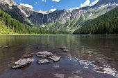 stock photo of avalanche  - A view toward Bearhat Mountain from Avalanche Lake in Glacier National Park Montana - JPG