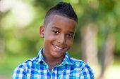 Outdoor Portrait Of A Cute Teenage Black Boy - African People