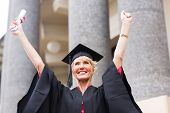 cheerful senior female university graduate arms up