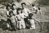 BIELSKO, POLAND, CIRCA 1940s - vintage photo of happy family enjoying bath in river