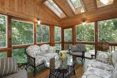 picture of screen-porch  - Wood paneled porch in suburban home with skylights - JPG