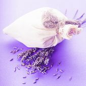 image of sachets  - Dried lavender sachet over purple bacgkround with flowers - JPG