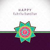image of rakhi  - Beautiful rakhi on brown and grey background for Raksha Bandhan celebrations - JPG