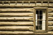 picture of log cabin  - Exterior wall and window of a pioneer log cabin - JPG