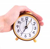 stock photo of stop hate  - Alarm clock and hand isolated on white - JPG