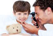 image of teddy-bear  - Attractive doctor examining patient - JPG