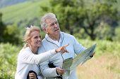 foto of orientation  - Senior hikers reading orientation map - JPG
