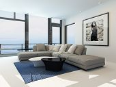 stock photo of lounge room  - Waterfront living room with a bright airy lounge interior with a comfortable modern upholstered grey suite  - JPG