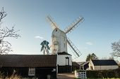 stock photo of fantail  - Saxtead Green Mill post mill with three storey roundhouse - JPG