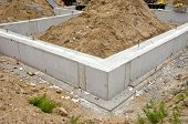 pic of earth structure  - concrete block foundation base for urban house - JPG