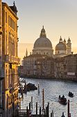 stock photo of salute  - Grand Canal and Santa Maria della Salute church at sunrise in Venice, Italy ** Note: Soft Focus at 100%, best at smaller sizes - JPG