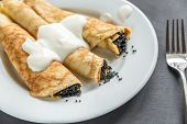 pic of crepes  - Crepes With Black Caviar On the Dark Background - JPG