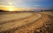 picture of raid  - Motocross and auto sport track with sunset sky background - JPG