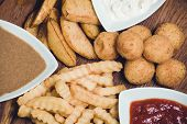 stock photo of dipping  - snack potato platter with dips on wooden board - JPG