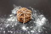 foto of baked raisin cookies  - oatmeal cookies with raisins and flour on wooden table - JPG