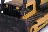 pic of bulldozer  - Shot of a toy bulldozer over white - JPG