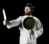 image of crazy hat  - Crazy chef isolated on a black background - JPG