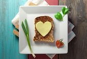 image of whole-grain  - Heart shape slice of cheese on toasted whole grain bread - JPG