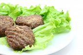 picture of veal  - veal cutlet steamed with lettuce on white background - JPG