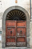 stock photo of entryway  - Entrance doors of an old church in Tuscany - JPG