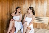 stock photo of sauna woman  - Young women relaxing on the bench in the sauna